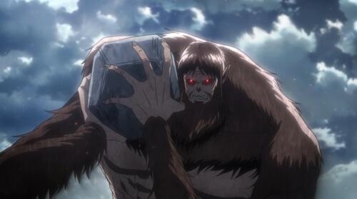 獣の巨人が投石を構える